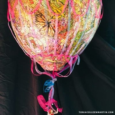 painted hot air balloon. Ours is a story of repair. Tonia Colleen Martin.